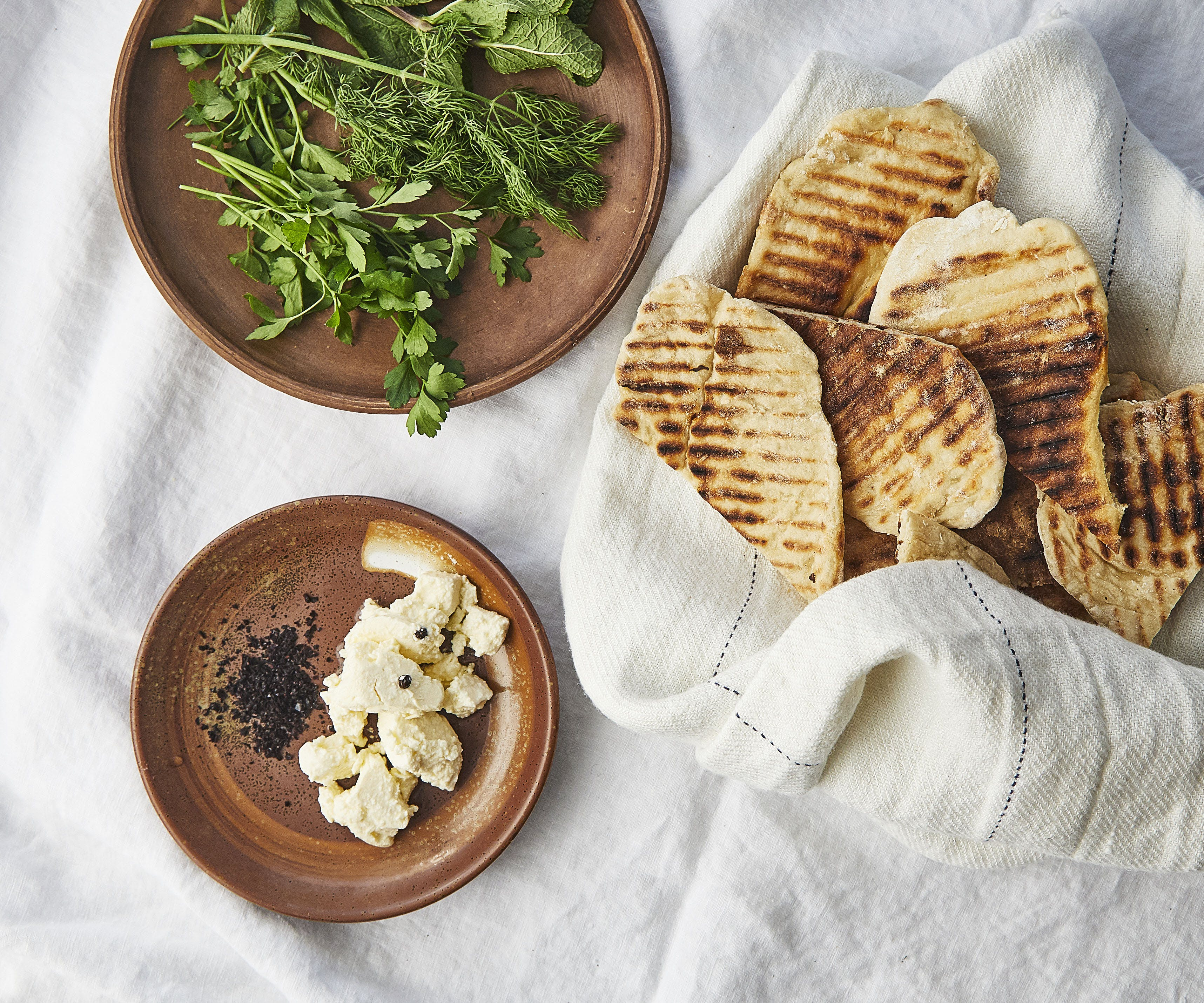 Homemade Flatbreads with Soft Cheese, Herbs and Pul Biber