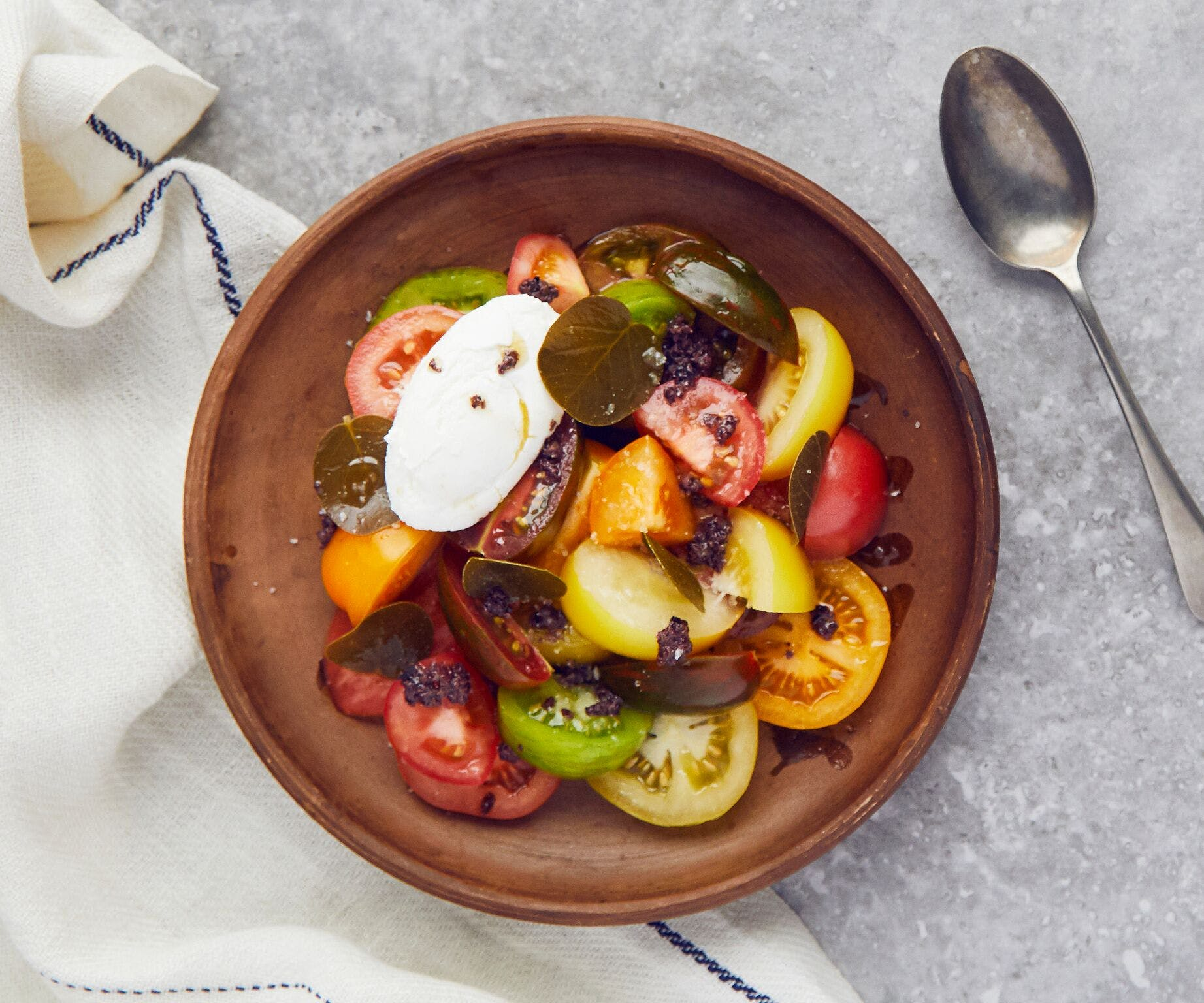 Heirloom Tomatoes with Goat's Curd, Tapenade and Wild Caper Leaves